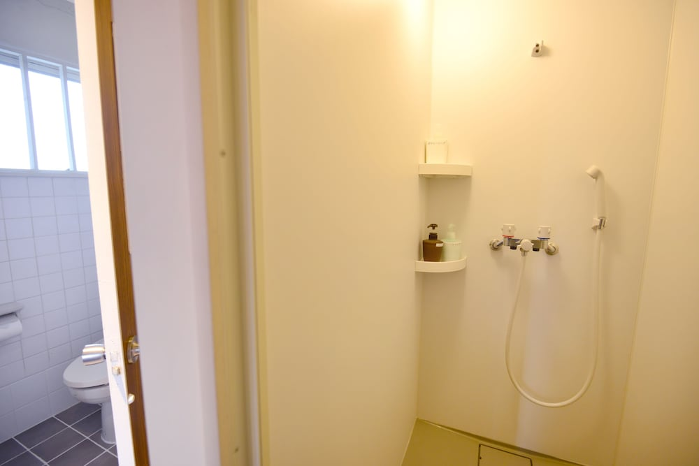Book guest house kala naha hotel deals for Z gallerie bathroom guest book