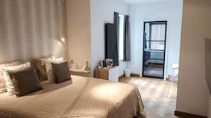 Premium bedding, free minibar items, desk, laptop workspace