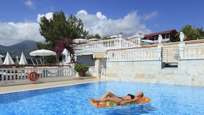 2 outdoor pools, open 9:00 AM to 7:00 PM, pool umbrellas, pool loungers