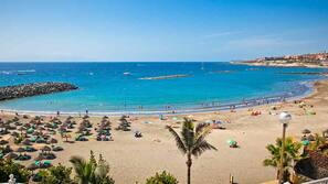 Beach nearby, black sand, sun-loungers, beach umbrellas