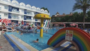Outdoor pool, open 8 AM to 6:30 PM, pool umbrellas, pool loungers
