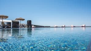 Outdoor pool, open 9 AM to 9:30 PM, pool umbrellas, pool loungers