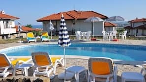 Indoor pool, 4 outdoor pools, open 8:00 AM to 6:00 PM, pool umbrellas