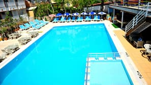Outdoor pool, open 9 AM to 7 PM, pool umbrellas, pool loungers