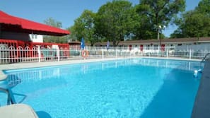 Seasonal outdoor pool, open 10:00 AM to 8:00 PM, pool umbrellas