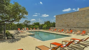 Outdoor pool, open 7:00 AM to 10:00 PM, pool umbrellas, sun loungers