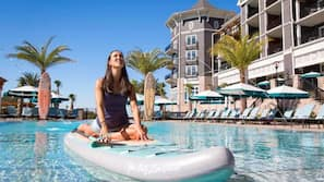 2 outdoor pools, open 9:00 AM to 10:00 PM, free cabanas, pool umbrellas