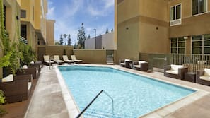 Seasonal outdoor pool, open 7:00 AM to 10:00 PM, pool loungers
