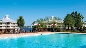 Indoor pool, 3 outdoor pools, open 10 AM to 10 PM, pool umbrellas