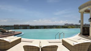 Outdoor pool, open 6:30 AM to 11:00 PM, pool umbrellas, pool loungers