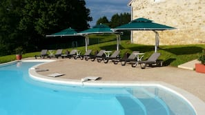 Indoor pool, outdoor pool, pool umbrellas, pool loungers