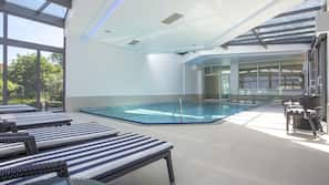 Indoor pool, open 9 AM to 9 PM, pool umbrellas, pool loungers