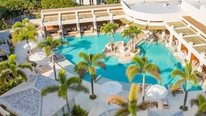 4 outdoor pools, free pool cabanas, pool umbrellas