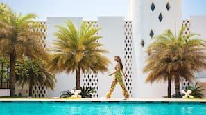 Indoor pool, 2 outdoor pools, cabanas (surcharge), pool umbrellas