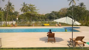 Outdoor pool, open 7 AM to 8:30 AM, pool umbrellas, pool loungers