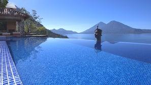 Seasonal outdoor pool, open 9:00 AM to 6:00 PM, sun loungers