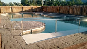 Seasonal outdoor pool, open 7:00 AM to 9:00 PM, free cabanas