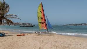 Private beach, sun-loungers, beach umbrellas, windsurfing
