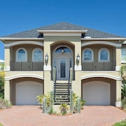 Coastal Karma 4 Br home by RedAwning