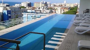 Outdoor pool, a rooftop pool, pool loungers