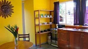 Full-size fridge, coffee/tea maker, cookware/dishes/utensils