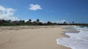 On the beach, white sand, beach umbrellas, beach yoga