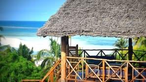 Ubicación cercana a la playa, arena blanca, toallas de playa y pesca