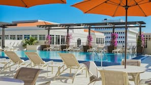 Outdoor pool, open 6:00 AM to 10 PM, pool umbrellas