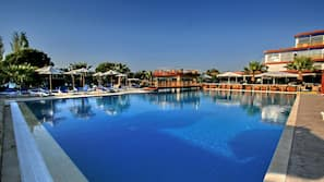 Indoor pool, seasonal outdoor pool, open 10 AM to 7 PM, pool umbrellas