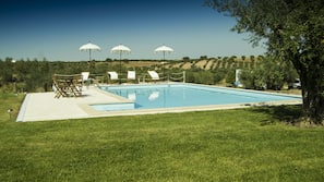 Seasonal outdoor pool, open 9 AM to 8 PM, pool umbrellas, sun loungers