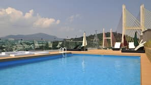 Seasonal outdoor pool, open 1:30 PM to 9:00 PM, pool umbrellas