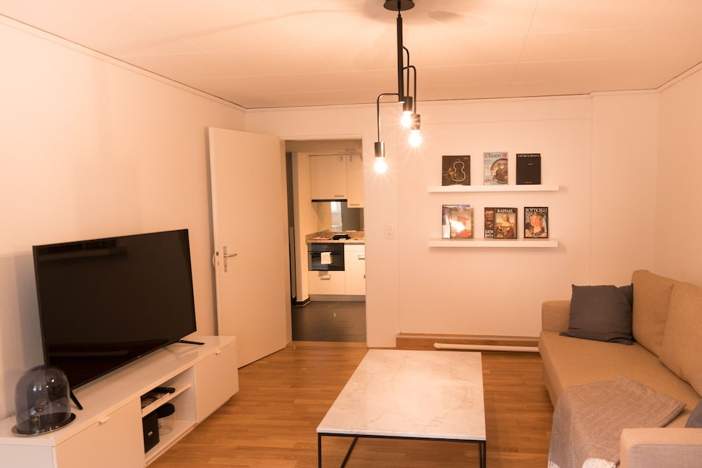 Living Room, Stylish Apartment in the Heart of Zug by Airhome