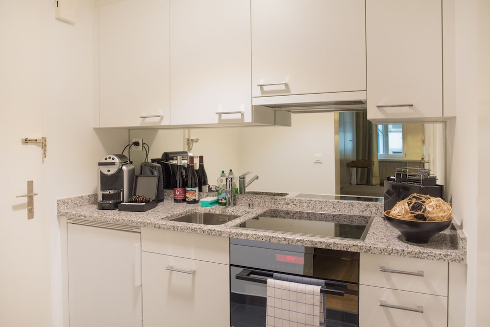 Private Kitchen, Stylish Apartment in the Heart of Zug by Airhome