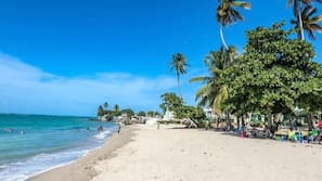On the beach, beach towels, beach volleyball