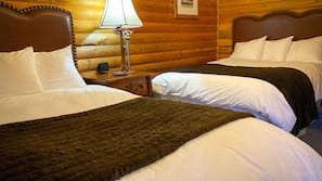 Premium bedding, blackout drapes, rollaway beds, free WiFi