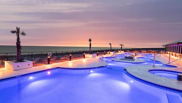 Indoor pool, outdoor pool, open 7 AM to 10:00 PM, pool umbrellas