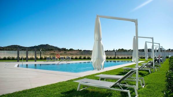 2 indoor pools, seasonal outdoor pool, pool umbrellas, sun loungers
