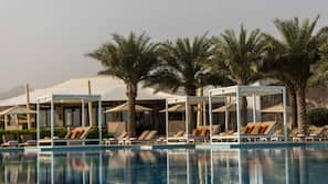 4 outdoor pools, open 7:00 AM to 8:00 PM, pool cabanas (surcharge)