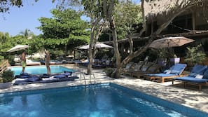 Outdoor pool, open 7 AM to 10 PM, free cabanas, pool umbrellas