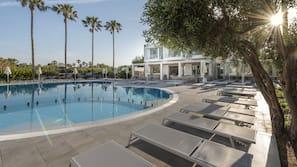 Seasonal outdoor pool, open 8:30 AM to 8 PM, pool umbrellas