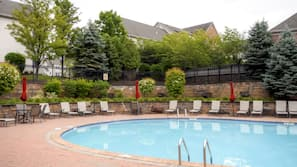 Seasonal outdoor pool, open 11:00 AM to 7:00 PM, sun loungers