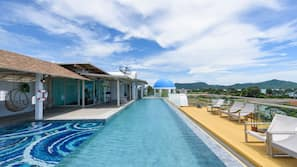 2 outdoor pools, open 7 AM to 8 PM, pool umbrellas