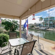 Canal House with Boat Dock and Pier by RedAwning