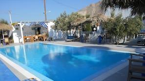 Seasonal outdoor pool, open 8:00 AM to 8:30 PM, pool umbrellas