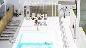 Outdoor pool, open 10 AM to 6:00 PM, pool loungers