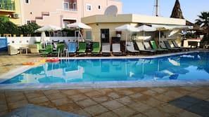 Seasonal outdoor pool, open 9:00 AM to 6:30 PM, pool umbrellas