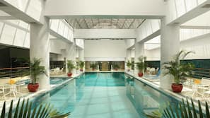 Indoor pool, open 6:00 AM to 11:00 PM, pool loungers, lifeguards on site
