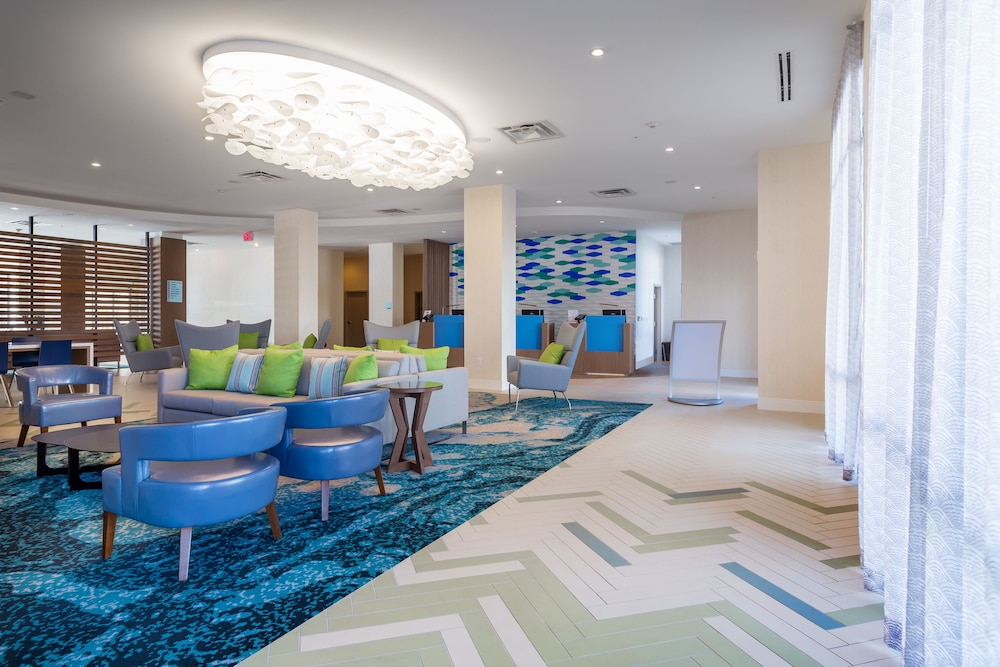 Lobby, Holiday Inn Express & Suites Orlando at SeaWorld, an IHG Hotel