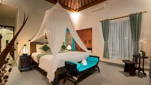 2 kamar tidur, seprai premium, minibar, dan brankas