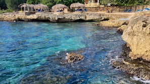 Private beach, free beach shuttle, beach towels, snorkeling